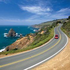 Driving on Highway 1 along California's coast in a convertible