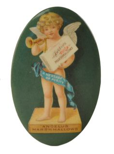 """Advertising celluloid pocket mirror for Angelus Marshmallows with curly haired cherub standing on a box and holding a box of Angelus Marshmallows, with a ribbon reading """"A Message of Purity"""". Celluloid and advertising are in bright and clean condition with only minor spotting on mirror. Edge marked """"Mirror Free with Package of Angelus Marshmallows. Ask Your Dealer or Send 3 - 2 cent Stamps to Rueckheim Bros. & Eckstein, Chicago."""" size: 1.75"""" x 2.75"""""""