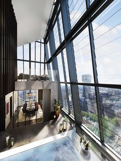 A rendering of the two-story winter garden that is part of the penthouse inside London's Dollar Bay development. The winter gardens have mechanical louvers that open to allow fresh air.