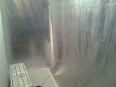 Plastic booth for dust and paint overspray containment.