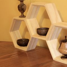 I love angles.. and this is just perfectly useful/pleasant. < Honeycomb Shelf  Set of Three Hexagon Shelves  by HaaseHandmade, $45.00