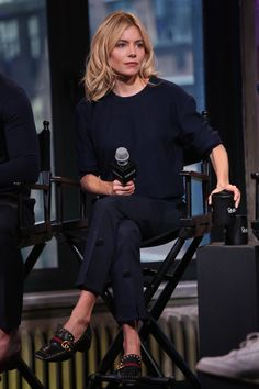 20 April Sienna Miller was in New York to promote her new film High-Rise wearing a pair of navy tailored trousers, a navy knit and Gucci loafers. - HarpersBAZAAR.co.uk