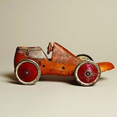 Charming wooden shoe last racer with metal meccano wheels, Plum & Ashby