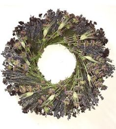 Dried Lavender Medley Wreath - a beautiful arrangement of naturally dried flowers and wheat will add color, fragrance, and visual interest to your interior decor. Perfect in an entry way, on a gallery wall, or in the main living space. This beauty will last for years with a little bit of care. Limited quantity available, order now! DriedDecor.com #interiordesign #homedecor #driedflowers #wreaths #wreathsforsale #summerdecor #lavender #gallerywall
