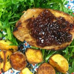 Roasted pork loin w raspberry shallots sauce over arugula w roared potatoes w chives