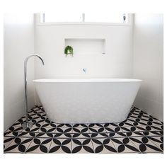Wavell Heights Bathroom - This monochrome space demonstrates the best of modern minimalism.  #homedesign  #queenslandhomes  #embraceconstruction  #brisbanebuilder  #bathroomdesign