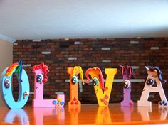 My Little Pony Inspired  Wooden Letters  by CreationsLK on Etsy    I make beautiful, one of kind hairpieces and accessories that will make your special day one to remember! Custom orders always welcome!  https://www.etsy.com/shop/sweetieworkshop
