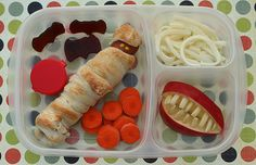 "Great Halloween Lunch - High on the Creepy Scale...In the big section:  mummified hot dog, vat of blood sauce - ew! (Don't worry, it's just ketchup!), fruit leather bats, ""pumpkin slices"" (carrot coins). Smaller sections:  extra mummy bandages (shredded string cheese!) & zombie jaws (apple slices & almond slivers). More about how to make this one at  Another Lunch  Thanks Melissa! You've totally creeped us out."