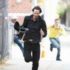 Kiano reeves running away from the paparazzi with their camera Bolly4u