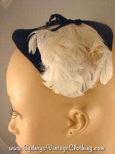"Veil-cap idea, I'd like a ""bird cage"" style veil with a cap like this I think"