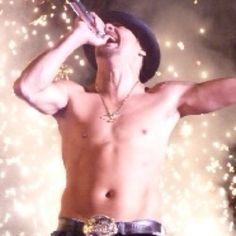 "My favorite part of a Kid Rock concert, shirtless, shower of pyrotechnics in the background , yelling ""my name is Kidddddd Rock"""