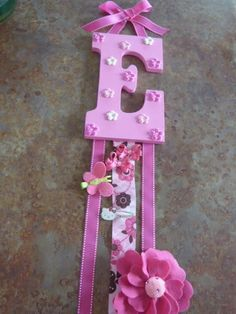 DIY Bow Holder no tut just this pic but soooo cute and looks easy to me, could use a lighter letter material than the wood like styrofoam