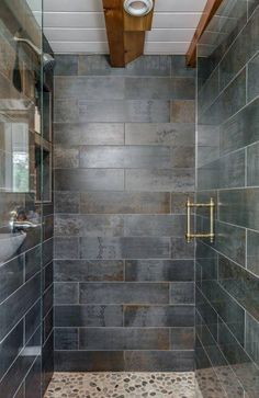 Tile Shower - Escher by New Frontier Tiny Homes Tiny house bathroom, bathroom layout, composting toilet, space-saving bathroom, bathroom storage, tiny house shower, tiny house bathtub, small shower room, small layout, narrow bathroom, composting toilet, tub design, tiny bathroom with a tub,