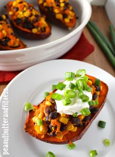 Southwest Stuffed Sweet Potatoes - a great way to mix up your complex carbs with delicious southwestern flavor. Servings: 4 • Calories per serving: 195 • Fat: 1 g • Protein: 9 g • Carbs: 40 g • Fiber: 8 g • Sugar: 9 g • Sodium: 232 mg • Cholesterol: 1 mg
