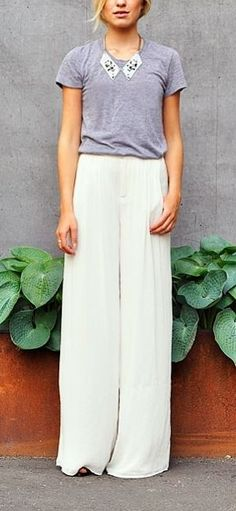 Flowy silk white wide leg trousers make it easy to pull off the effortless chic look this season.