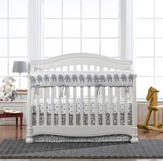 Mix and match your nursery bedding using this Elephant rail cover, Gray and White Polka Dot crib sheet, and a Gray Gigi crib skirt all from Liz and Roo!
