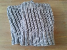 I did these 2-tone switching after about 12 rows. Started with 4 rows of 1x1 ribbing using long tail CO then ended with 4 rows of 2x2 ribbing and ended with suspended BO. 2nd time flared more, must not have been as tight. Not a big deal because it will all stretch evenly around my calf. Not stretchy or pretty enough of a BO for ear warmer. Prefer the 1x1 ribbing. Used Lion Brand 100% wool from Caleb. Kind of bulky and makes my boots fit real tight. Try using DK weight yarn.