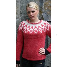 Red, hand knitted pullover with a white pattern. Made with Plotulopi wool yarn.