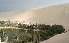 Huacachina Oasis Huacachina, Peru  Surrounded by sand dunes, the village of Huacachina is crowded around a natural lake in the middle of the desert. Only 115 people live in this small community, but it attracts many international visitors who wish to view its unique location. Unfortunately, many wells have been dug to reach groundwater and have drained the lakes levels over the years.
