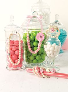 Display jewelry on candy jars. This will get your booth lots of attention #jewelryinspiration #cousincorp