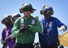 Sailors assigned to the aircraft carrier USS Nimitz (CVN 68) participate in a simulated fire drill on the flight deck.