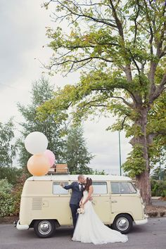 VW Camper van wedding transport and giant pastel colour balloons.  http://www.cottoncandyweddings.co.uk/