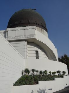 Griffith Observatory is in Los Angeles, California, United States. Sitting on the south-facing slope of Mount Hollywood in L.A.'s Griffith Park, it commands a view of the Los Angeles Basin, including downtown Los Angeles to the southeast, Hollywood to the south, and the Pacific Ocean to the southwest. The observatory is a popular tourist attraction with an extensive array of space and science-related displays.