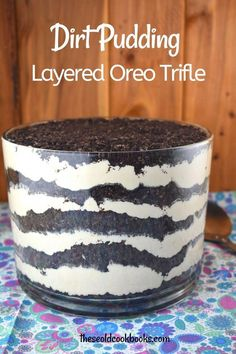 Oreo Dirt Pudding Trifle combines a famous chocolate sandwich cookie, puddling and cream cheese. The result is a match made in heaven. This dessert is an all-time favorite of adults and kids alike with layers of crushed Oreo cookies sandwiched between a decadent cream cheese pudding layer. #LemonCakeWithBlueberriesRecipe Oreo Dirt Dessert, Oreo Pudding Dessert, Banana Pudding Trifle, Trifle Desserts, Dessert Recipes, Oreo Trifle, Pudding Cookies, Frozen Desserts, Dessert Ideas