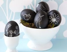 chalkboard painted eggs-we are totally doing these this year..a little more mature for my teenagers!