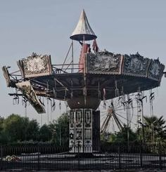 """I think most people who have ever been to a country fair have ridden on this classic """"swing ride"""" - I love this photo showing what happens when it's just left to decay."""