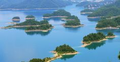 """Not more than 300 kilometers from the east coast of China, in Zhejiang province, sits Qiandao Lake.Known for its clear, sometimes drinkable water and manifold of lush, white sand islands, it is truly a picturesque place. But something far more special lies beneath its surface - the ancient city of Shicheng, or, as travelers like to call it, the """"Atlantis of the East."""""""