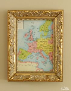 Frame an old map as easy instant thrifty artwork!  - see more ideas like this at our full house tour