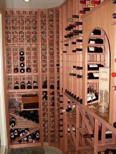 Wine racks with brick behind (think that I prefer the paint or wood background to the brick backgound)