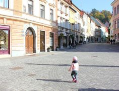 Child running in the pedestrian streets of the Old Town in Ljubljana, Slovenia