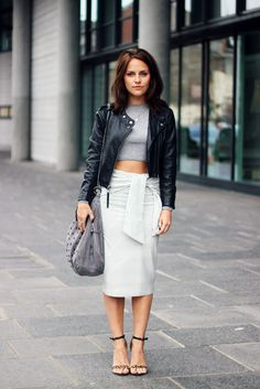 Amy Spencer is wearing a tie waist skirt from Zara, cropped jumper from TopShop, bag from Paul's Boutique and leopard shoes from MissGuided