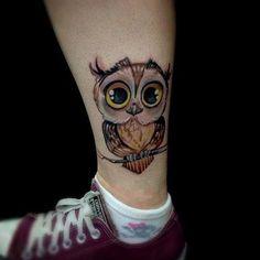 Owl tattoo on the lower leg