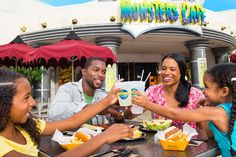 NBC Sports grill & Brew   A family of four toasts their drinks while enjoying a meal at Universal Studios Orlando.