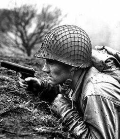 WWII infantryman with 1911 Colt pistol