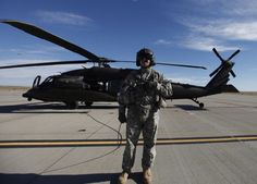 South Dakota Army National Guard Sgt. 1st Class Gregg Holland stands near the National Guard's HH-60M Black Hawk helicopter Wednesday. The helicopter is the first of six the guard will acquire to replace the current inventory of six UH-60A/L model Black Hawks.