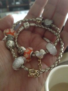 Pandora champagne leather bracelet.