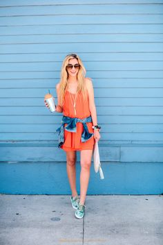 Bright colored dress + sneakers + sunglasses