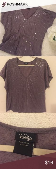 Vanity blouse Purple shimmer blouse with sequins adorning the whole front of the top! So adorable on! Gently used but in perfect condition! No rips or stains. Vanity Tops Blouses