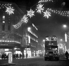 Christmas lights of shimmering stars hang over Lord Street near the corner of Whitechapel, Liverpool. 25th November 1962