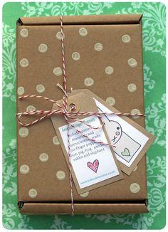 Kraft colored parcel + white dots.  Love.