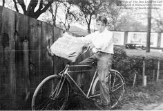 Photograph of a Mobile Press newspaper delivery boy astride a bicycle. The bag on the handlebars of the bicycle is stuffed full of newspapers.