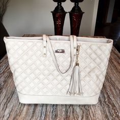 NWT..BCBG tan quilted large tote NWT..BCBG Paris tan quilted large tote. Gold hardware with leather toggle. This is a very large tote bag. Brand-new with tags. BCBG Bags Totes