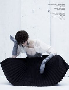 Chalk – Amber Anderson exudes dark minimalism for the latest issue of Schon Magazine. Photographed by Diego Indraccolo with styling by Kay Korsh, Amber dons revealing pieces from the likes of Christopher Kane, Marni and Antonio Beradi in the haunting images. / Hair by Peter Lux, Makeup by Afton Radojicic, Set design by Eoin Dillon