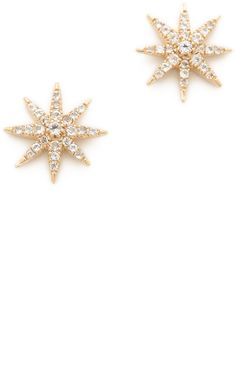 White topaz-studded stars twinkle from these Elizabeth and James earrings. Post closure. <ul> <li>22k gold plate.</li> <li>Imported, Thailand.</li> </ul>