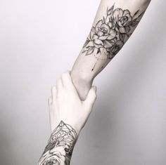 Blackwork roses on forearm by Maria Fernandez