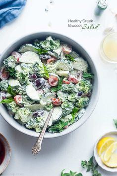 Greek Healthy Broccoli Salad - This low carb, raw broccoli salad is so creamy you'll never know it's vegan, paleo and whole30 compliant! It's an easy side dish that's perfect for spring potlucks!   Foodfaithfitness.com   @FoodFaithFit